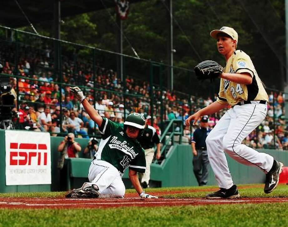 Westport's Charlie Roof slides safely into home plate in the top of the second inning against Eastlake on Sunday in the Little League World Series. Photo by Mary Albl - New Haven Register