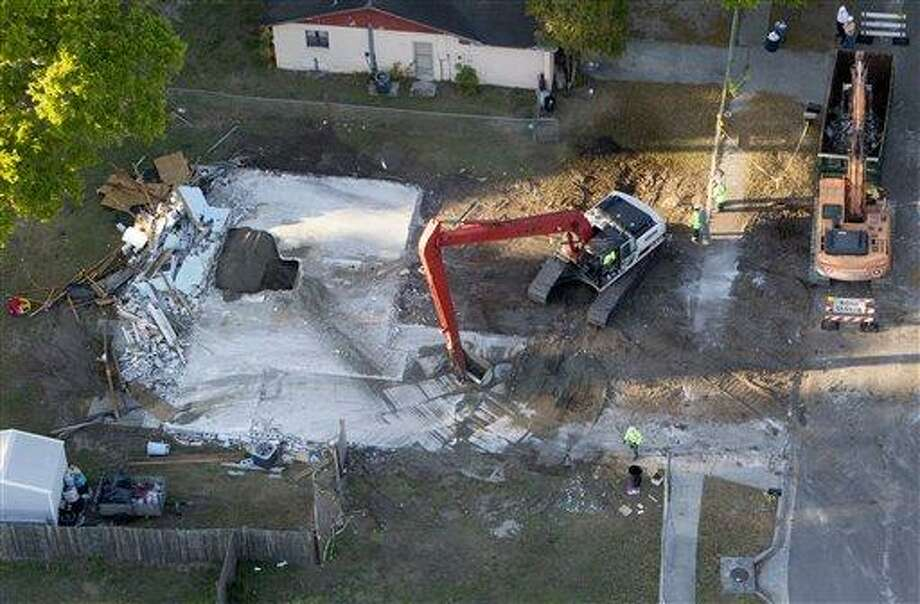 This March 5 aerial photo shows demolition workers picking up the remnants from the home of Jeff Bush in Seffner, Fla. Associated Press Photo: AP / The Tampa Bay Times