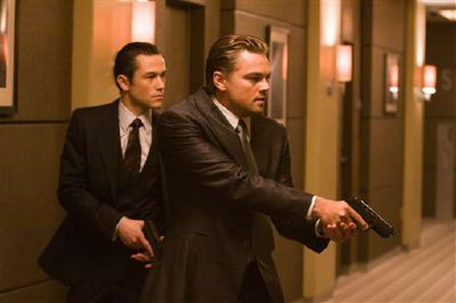 "In this film publicity image released by Warner Bros., Joseph Gordon Levitt, left, and Leonardo DiCaprio are shown in a scene from ""Inception."" Gun violence in PG-13 rated movies has increased considerably in recent decades, to the point that it sometimes exceeds gun violence in even R-rated films, according to a study released Monday. Photo: AP / Warner Bros."