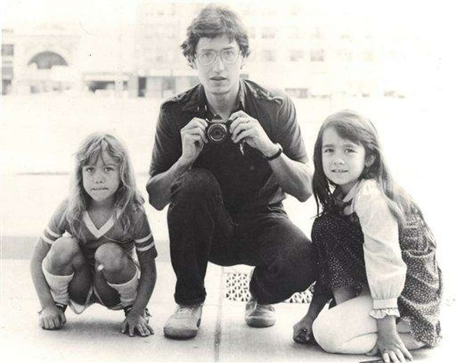 """In this undated photo provided by Keely Walker Muse, her father journalist John Clay Walker poses for a portrait with his daughters Lannie, left, and Keely in Minneapolis, Minnesota. Mexican drug lord Rafael Caro Quintero was sentenced to 40 years in prison for the 1985 murders of Walker, his friend Alberto Radelat, and DEA agent Enrique """"Kiki"""" Camarena, among other crimes. According to witnesses interviewed by DEA agents hunting for Camarena's killers, the cartel had mistaken Walker and Radelat for undercover agents. Caro Quintero walked free in August 2013, 12 years early after a local appeals court overturned his sentence for three of the murders. Walker was a Marine who was twice wounded by land mines in Vietnam and then worked as a newspaper journalist before taking his family to Mexico so he could write his book in a place where his pension could stretch further. He and his wife were befriended by Radelat, a dentist looking at taking classes at the main university in Guadalajara. (AP Photo/Courtesy Keely Walker-Muse) Photo: AP / Keely Walker Muse"""
