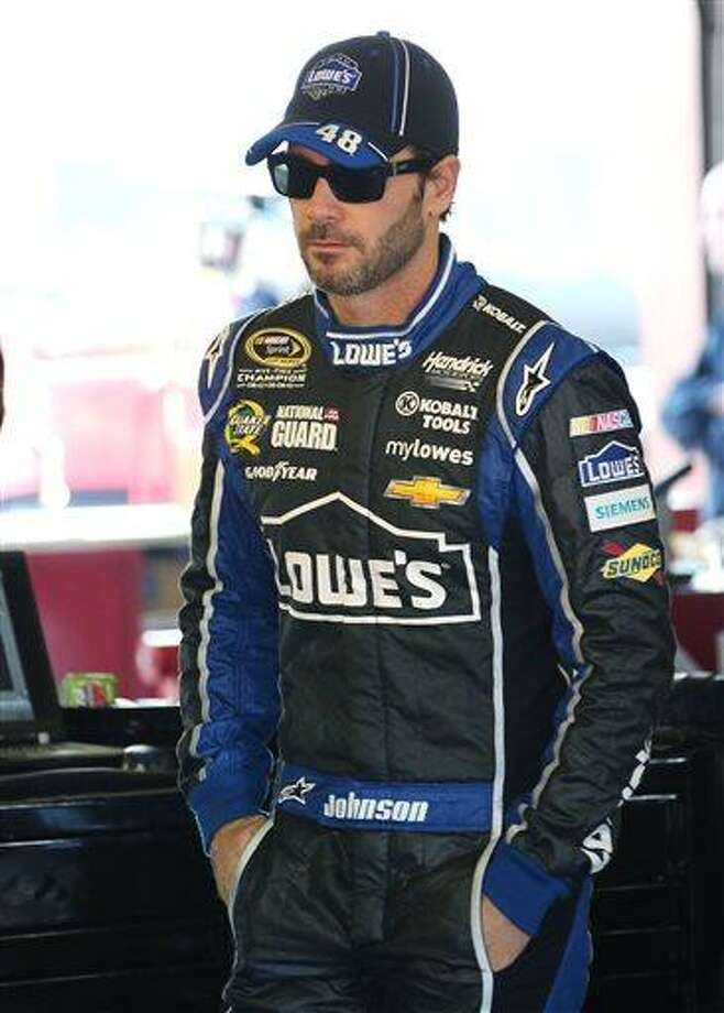 Jimmie Johnson watches as the crew works on his car during practice for the NASCAR Sprint Cup Series auto race at Michigan International Speedway in Brooklyn, Mich., Saturday, Aug. 17, 2013. (AP Photo/Bob Brodbeck) Photo: AP / FR3471 AP