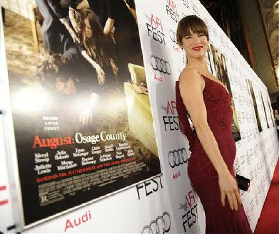 "Juliette Lewis arrives on the red carpet last Friday at the 2013 AFI Fest premiere of ""August: Osage County"" at the TCL Chinese Theatre in Los Angeles. Photo: Chris Pizzello/Invision/AP / Invision"