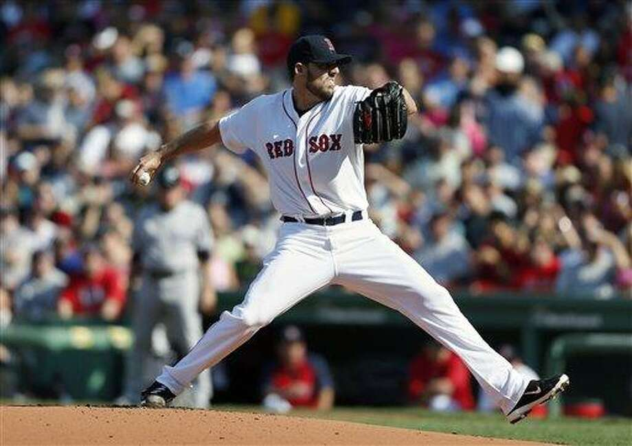 Boston Red Sox's John Lackey pitches in the first inning of a baseball game against the New York Yankees in Boston, Saturday, Aug. 17, 2013. (AP Photo/Michael Dwyer) Photo: AP / AP