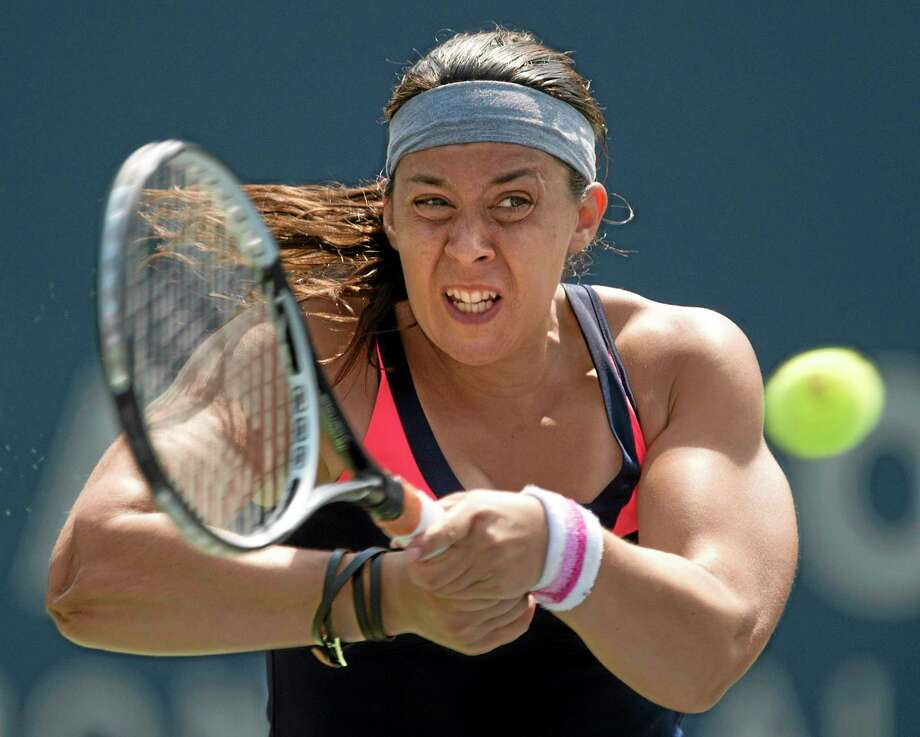 Wimbledon champion Marion Bartoli was slated to play in the New Haven Open but announced her retirement on Wednesday. Photo: Frank Gunn — The Associated Press  / CP