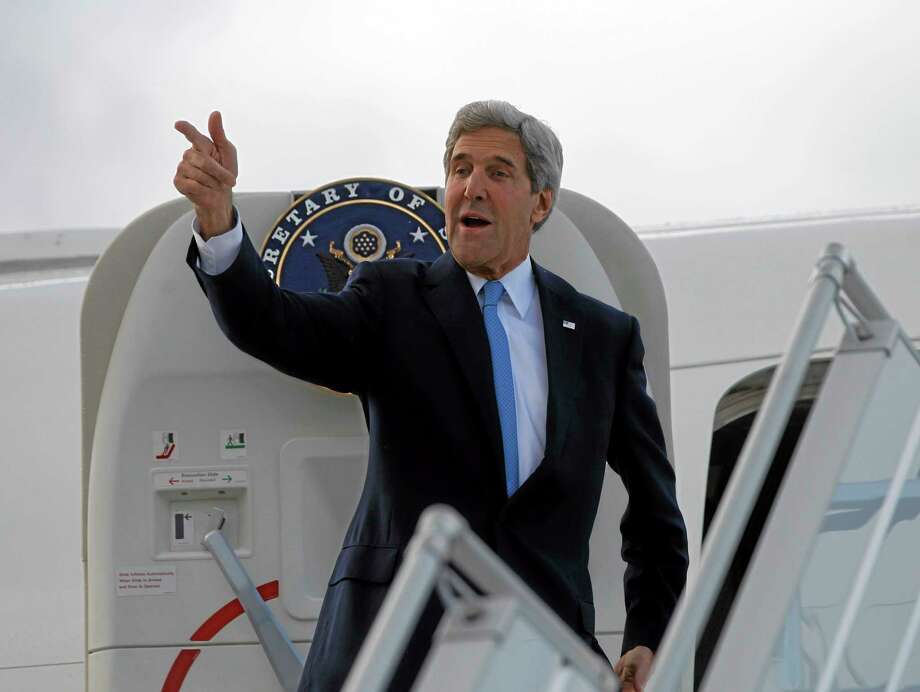 "In this Nov. 10, 2013, photo, U.S. Secretary of State John Kerry steps aboard his aircraft in Geneva, Switzerland. Nuclear talks with Iran have failed to reach agreement, but Kerry said differences between Tehran and six world powers made ""significant progress."" For President Barack Obama, the Iranian nuclear deal he covets now depends in part on his ability to keep a lid on hard-liners on Capitol Hill and an array of anxious allies abroad, including Israel, the Persian Gulf states, and even France.  (AP Photo/Jason Reed, Pool) Photo: Ap / Reuters"