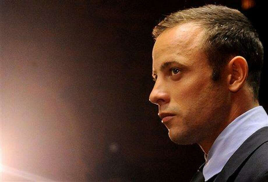 FILE - In this  Friday, Feb. 22, 2013 file photo  Olympic athlete Oscar Pistorius stands in the dock during his bail hearing at the magistrates court in Pretoria, South Africa.  South Africa's police commissioner office said Tuesday Aug. 13, 2013 that Oscar Pistorius will be served with an indictment next week after police completed an investigation into the shooting death of his girlfriend.   On Monday August 19,  the accused,Oscar Pistorius, will appear on court in Pretroia. It is expected that he will be served with an indictment and that the matter will be postponed. The prosecution, in collaboration with the defence team, will agree on a trial date.  (AP Photo/Themba Hadebe-file) Photo: AP / AP