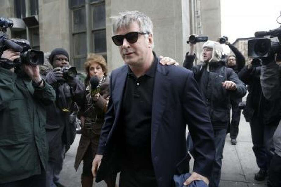 Actor Alec Baldwin leaves criminal court in New York, Tuesday, Nov. 12, 2013. Baldwin testified Tuesday that he never had a sexual or romantic relationship with Canadian actress Genevieve Sabourin, who is accused of stalking him. He said that after they met she began leaving dozens of voice mails for him a night and eventually started threatening to show up at his homes.