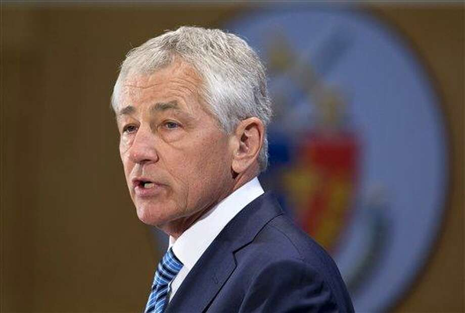Defense Secretary Chuck Hagel speaks at the National Defense University at Fort McNair in Washington, Wednesday, April 3, 2013. Hagel warned of sharply deeper cuts to personnel, health care and weapons systems across his department, in order to put the brakes on spiraling costs and reshape the military for leaner budgets and new challenges.  (AP Photo/Manuel Balce Ceneta) Photo: AP / AP