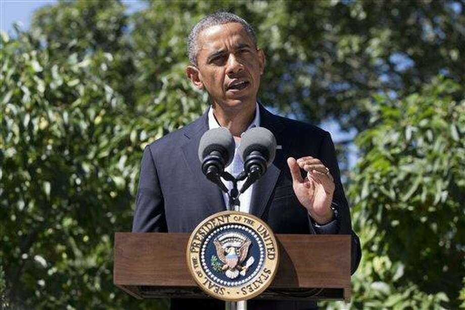 President Barack Obama makes a statement to the media regarding events in Egypt, from his rental vacation home in Chilmark Mass., on the island of Martha's Vineyard, Thursday, Aug. 15, 2013. The president announced that the US is canceling joint military exercise with Egypt amid violence. (AP Photo/Jacquelyn Martin) Photo: AP / AP