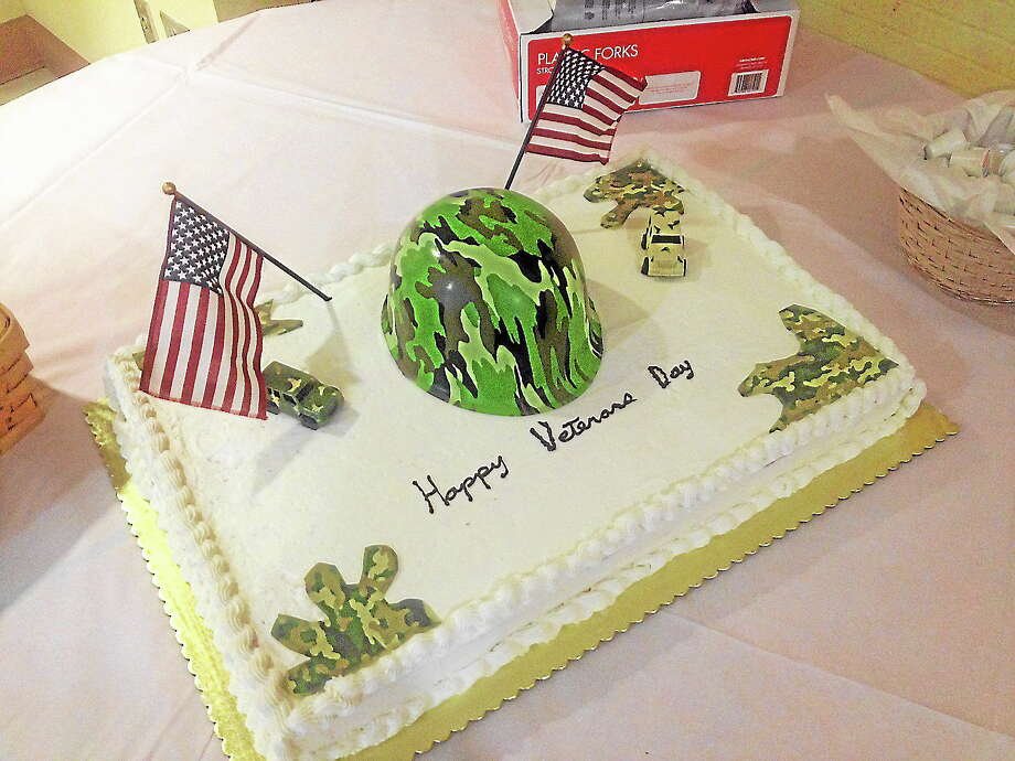 Portland vets enjoyed dinner and cake at their annual gathering Monday. Photo: Jeff Mill - The Middletown Press
