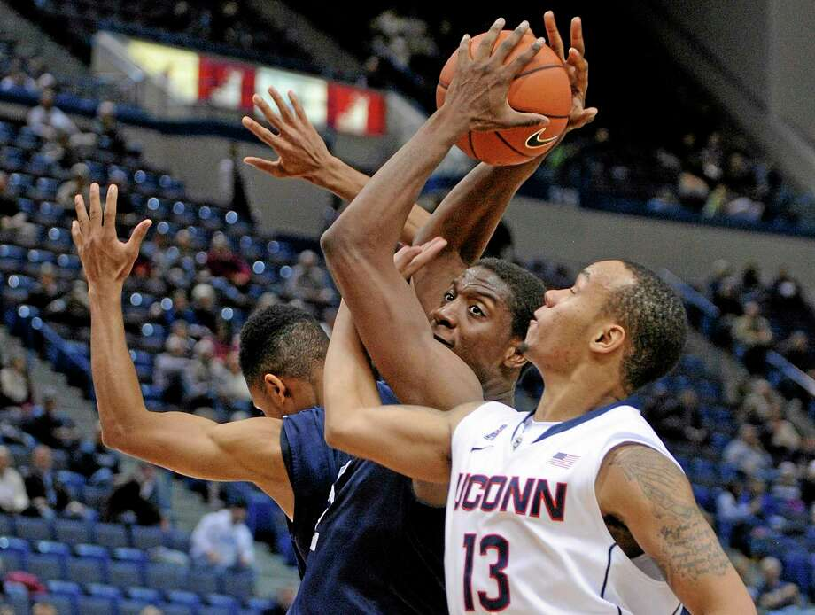 UConn's Shabazz Napier fights for a rebound with Yale's Justin Sears during the second half Monday. Photo: Fred Beckham — The Associated Press  / FR153656 AP