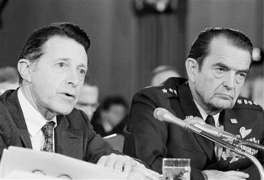 FILE - Secretary of Defense Caspar Weinberger, left, and Air Force Gen. David Jones, chairman of the Joints Chiefs of Staff appear before the Senate Foreign Relations Committee on Capitol Hill in Washington in this Thursday, Oct. 2, 1981 file photo. Jones, a retired Air Force general who helped set in motion a far-reaching reorganization of the U.S. military command while serving as chairman of the Joint Chiefs of Staff, has died at 92. The general's son, David Curtis Jones, said Wednesday Aug. 14, 2013 that his father died Saturday at a military retirement community in Potomac Falls, Va. He had Parkinson's disease. (AP Photo/ Ira Schwarz, File) Photo: AP / AP