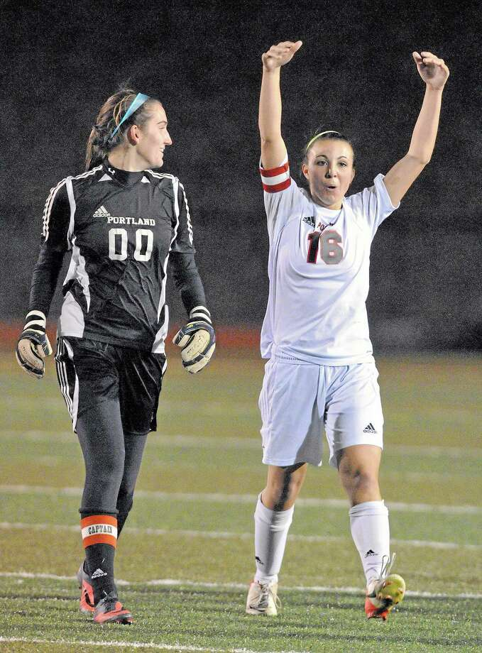 Portland senior co-captains Nicole Caruso and goalie Marisa DiMare celebrate after defeating Coventry in the CIAC Class S semifinal game at Middletown High School Monday evening. Portland won 2-1 and will play Saturday in the state championship game. Photo: Catherine Avalone — The Middletown Press  / TheMiddletownPress