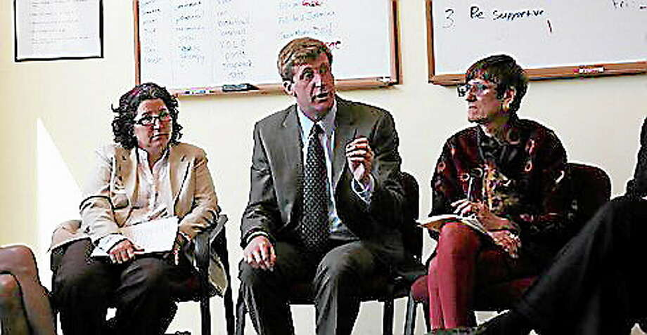 Healthcare Advocate Victoria Veltri, former U.S. Rep. Patrick Kennedy, and U.S. Rep. Rosa Delauro in April at the Clifford Beeres Clinic in New Haven. Photo: Journal Register Co.