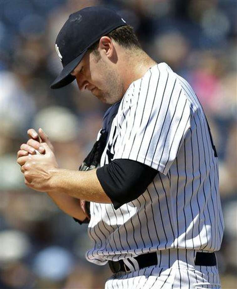 New York Yankees starting pitcher Phil Hughes reacts after allowing a fourth-inning solo home run to Los Angeles Angels' Chris Nelson in a baseball game, Thursday, Aug. 15, 2013, in New York. (AP Photo/Kathy Willens) Photo: AP / AP