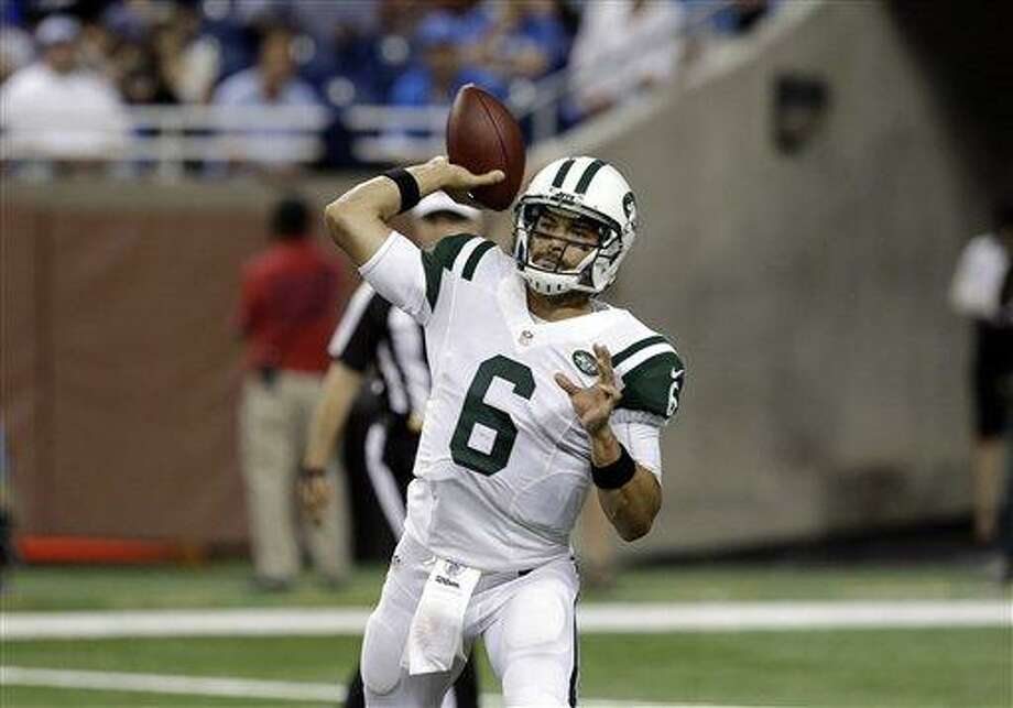 New York Jets quarterback Mark Sanchez throws against the Detroit Lions in the first half of a preseason NFL football game in Detroit, Friday, Aug. 9, 2013. (AP Photo/Paul Sancya) Photo: AP / AP