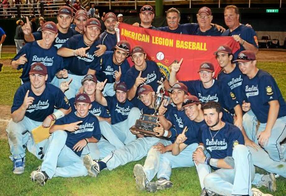 PHOTO BY DAVE PHILLIPS     The Branford American Legion Post 103 baseball team celebrates after winning the Northeast Regional title at Palmer Field. Branford will play Wilmington (N.C.) in their World Series opener tonight (ESPN3.COM,) in Shelby (N.C.).