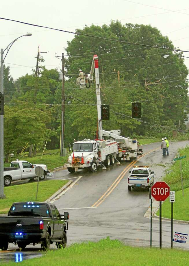 Alabama Power Company crews work on power lines knocked down by a UPS cargo plane which crashed at the Birmingham International airport in Birmingham, Ala. on Wednesday, Aug. 14, 2013. (AP Photo/Butch Dill) Photo: AP / FR111446 AP