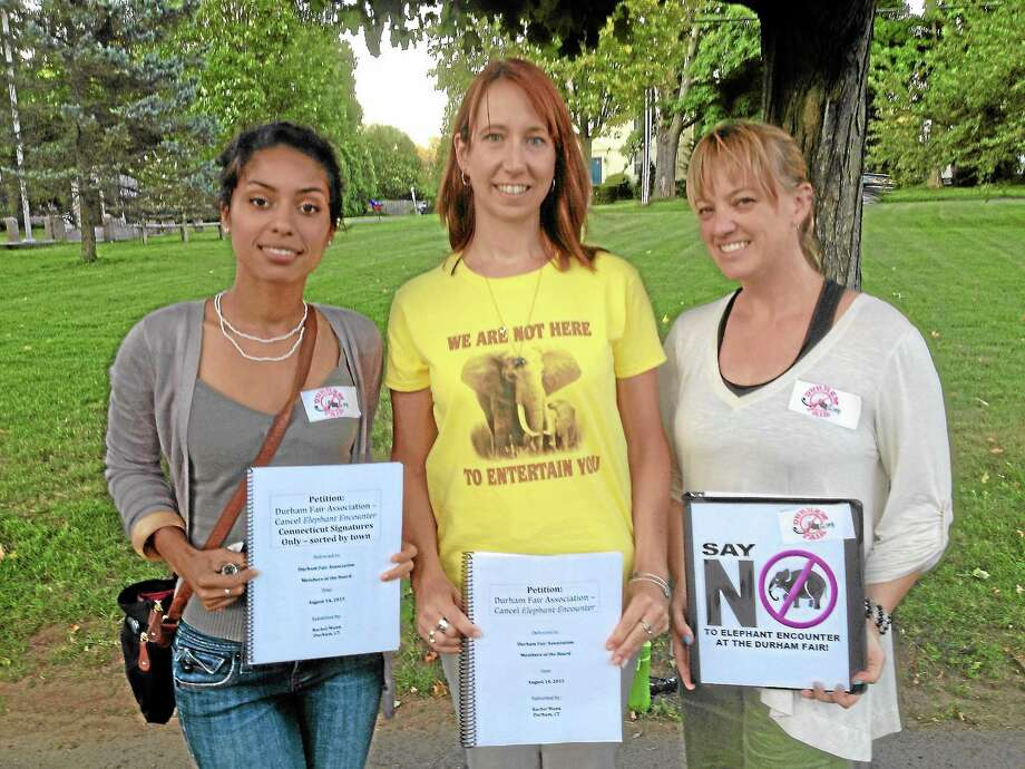 "From left, local residents Rachel Gary, Rachel Mann and Jenn Kinzel led a petition to encourage Durham Fair Association officials to cancel the ""Elephant Encounter"" attraction this year. Fair Association members voted to keep the event by a 59-12 margin Wednesday. Mike T. Lyle — The Middletown Press Photo: Journal Register Co."