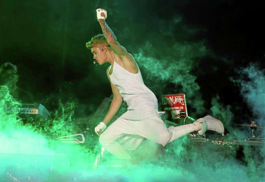 Canada's pop star Justin Bieber performs in concert during his Believe world tour  in Asuncion, Paraguay, Wednesday, Nov. 6, 2013. (AP Photo/Jorge Saenz) Photo: AP / AP