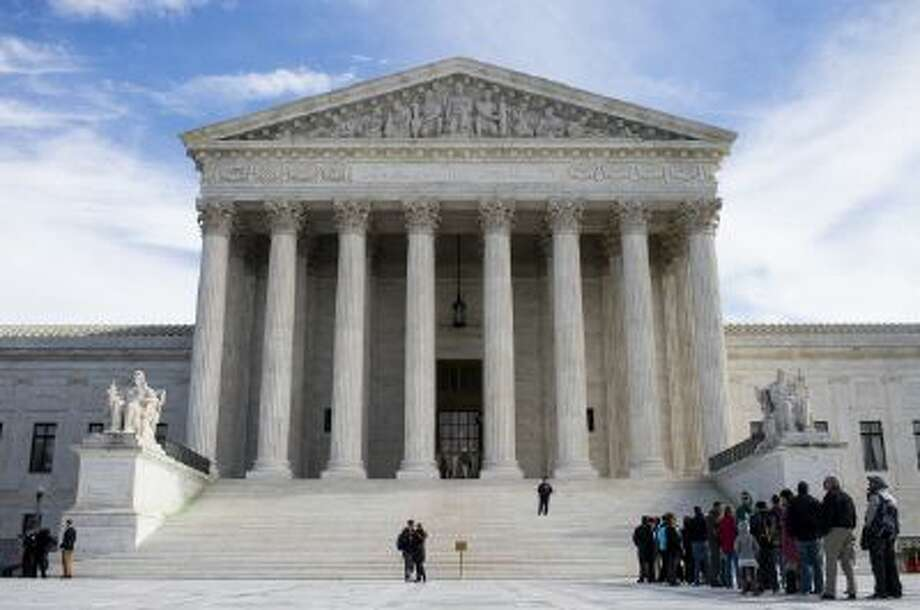 Visitors line up to enter the U.S. Supreme Court on Monday, Nov. 4, 2013. / © 2013 CQ Roll Call