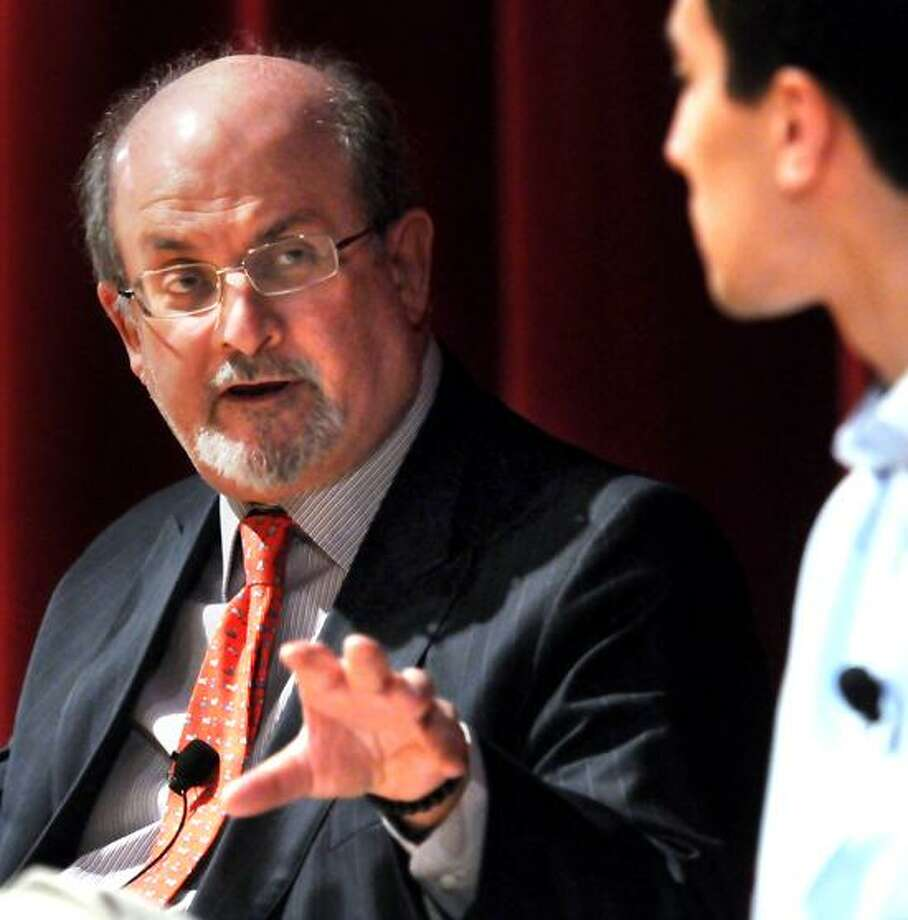 The author Salman Rushdie speaks with Yale sophomore Noah Remnick at the Yale Art Gallery. The talk was sponsored by the Yale Center for the Study of Globalization an undergraduate journal called The Politic. Mara Lavitt/New Haven Register4/2/13