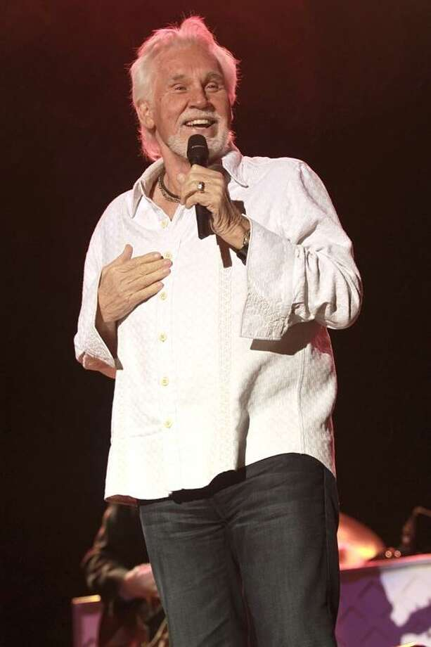 "Singer, songwriter, photographer, record producer, actor and entrepreneur Kenny Rogers is shown performing on stage during a ""live"" concert appearance. Photo: John Atashian / Www.concertphotos.com / John Atashian"