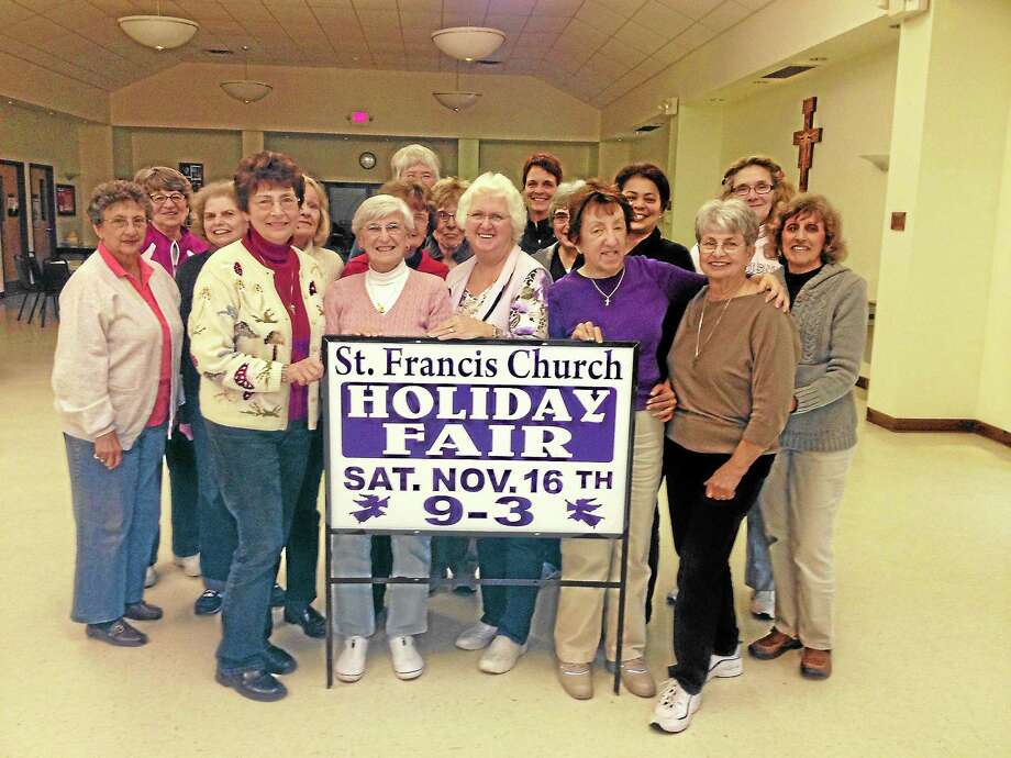 Members of St. Francis of Assisi Church are helping to promote the annual holiday fair, which takes place Nov. 16. Photo: Submitted Photo