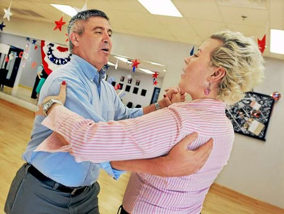 "Professional competive dancer Marlena Chabowska, an instructor at Fred Astaire Dance Studio instructs Jim Lucas in the proper technique of the waltz Monday afternoon at the Middletown studio. Lucas, a retired Command Chief Master Sergeant with the United States Air Force will compete in ""Dancing With Our Heroes"", a gala honoring the U.S. Military which will benefit The Friends of Fisher House Connecticut. Catherine Avalone - The Middletown Press / TheMiddletownPress"