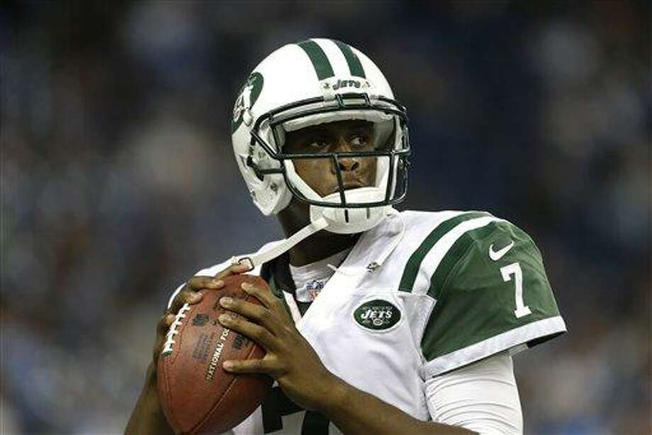 New York Jets quarterback Geno Smith warms up in the first half of a preseason NFL football game against the Detroit Lions in Detroit, Friday, Aug. 9, 2013. (AP Photo/Paul Sancya) Photo: AP / AP