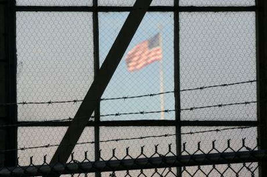 In this photo reviewed by the U.S. Department of Defense, a U.S. flag waves above the the Camp Justice compound at Guantanamo Bay U.S. Naval Base, Cuba, Oct. 17. Photo: ASSOCIATED PRESS / AP2012
