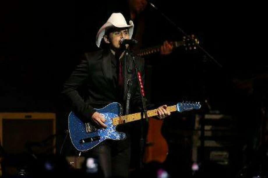 Singer Brad Paisley performs during the Inaugural Ball at the Walter E. Washington Convention Center on January 21, 2013 in Washington, DC. President Obama was sworn in for his second term earlier in the day Photo: Getty Images / 2013 Getty Images