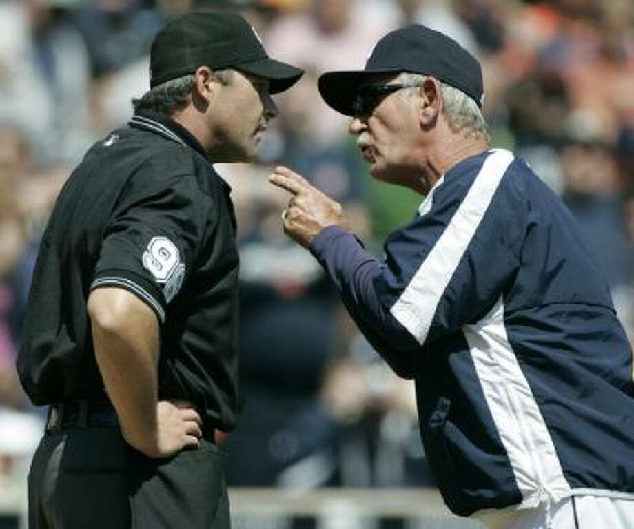 Former Detroit Tigers manager Jim Leyland, right, argues with an umpire. A new rule being considered could put widespread instant replay into effect.