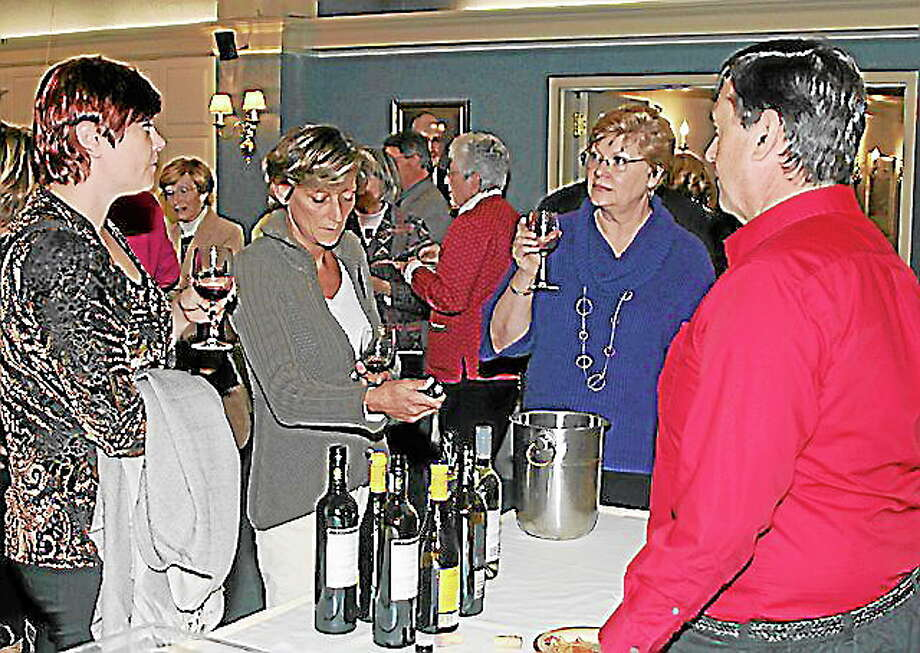 "LVVS 3rd   Annual Wine and Brew's Fine Food and Festive Crowd Warmed Chilly   Night  Literacy Volunteers Valley Shore held its Third Annual Wine & Brew Tasting and   Silent Auction on Friday October 25th  Essex, CT. The event was sponsored by Essex Meadows and Centerbrook   Package Store as well as Bailey, Murphy & Scarano LLC and Aztec Technology   People and drew a crowd of 60 who enjoyed scrumptious food, a wide variety of   wines and micro brews and bid on a selection of over 45 auction items during the   course of the evening. LVVS Executive Director, John Ferrara noted, ""This event   was, by far, the most fun and biggest success in our history."" He added, ""Thanks   so much to our wine vendors, David Reynolds of Essex Meadows and Bob Grillo   of Centerbrook Package Store who made this night possible.""   As an accredited affiliate of ProLiteracy America, LVVS is in its third decade   of helping people in Valley Shore towns learn to read, write, and speak better   English to improve their work and life. These services are free of charge to the   student and completely confidential. For further information contact the Literacy   Volunteers office by calling (860) 399-0280, email info@vsliteracy.org or visit our   website at www.vsliteracy.org.  , 2013 at Essex Meadows, 30 Bokum Road,   # # #     For more information about this release, contact,  Literacy Volunteers Valley Shore CT., Inc.  John Ferrara, Executive Director  (860) 399-0280 or by e-mail at  jferrara@vsliteracy.org Photo: Journal Register Co."