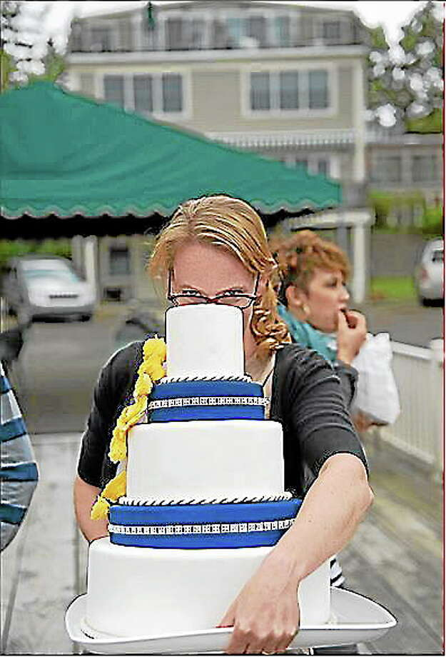 Hope Wright, head chef and creative director of A Little Imagination Cakes, carefully carries one of her creations to a client. Photo: Submitted Photo