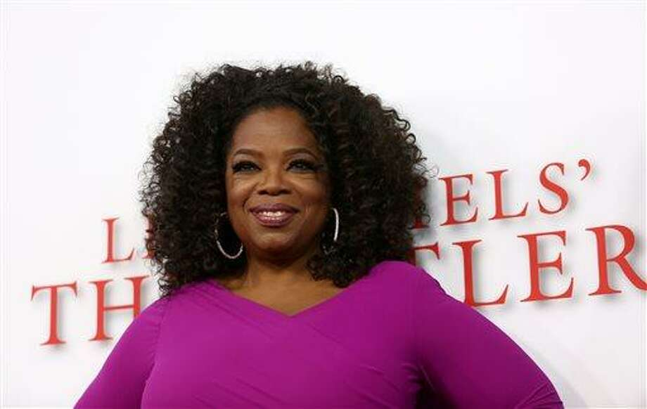 "Oprah Winfrey arrives at the Los Angeles premiere of ""Lee Daniels' The Butler"" at the Regal Cinemas L.A. Live Stadium 14 on Monday, Aug. 12, 2013. (Photo by Matt Sayles/Invision/AP) Photo: Matt Sayles/Invision/AP / Invision"