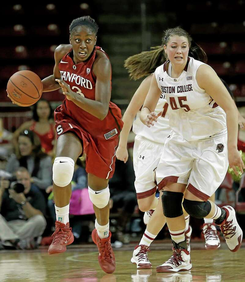Stanford's Chiney Ogwumike sprints up court past Boston College's Katie Zenevitch during their game on Saturday. Photo: Winslow Townson — The Associated Press  / FR170221 AP