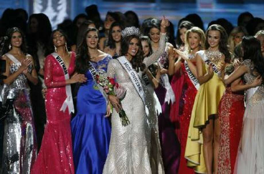 Miss Universe 2013 Gabriela Isler, from Venezuela, center, gestures after winning the 2013 Miss Universe pageant in Moscow, Russia, Saturday, Nov. 9, 2013.