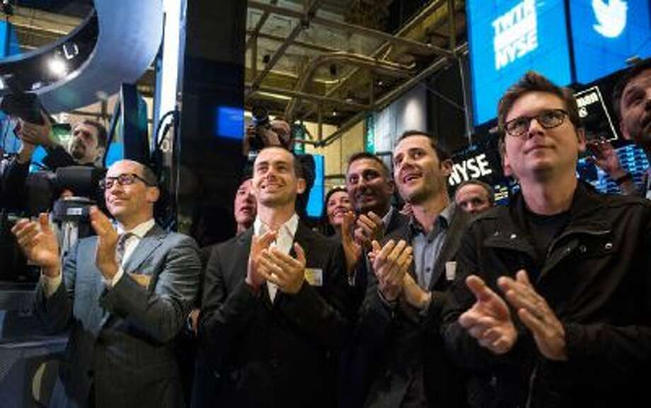 Twitter CEO Dick Costolo, Twitter co-founder Jack Dorsey, Twitter co-founder Evan Williams and Twitter co-founder Biz Stone applaud as Twitter rings the opening bell at the New York Stock Exchange (NYSE) while also celebrating the company's IPO on November 7, 2013 in New York City. Twitter went public November 7, on the NYSE selling at a market price of $45.10.