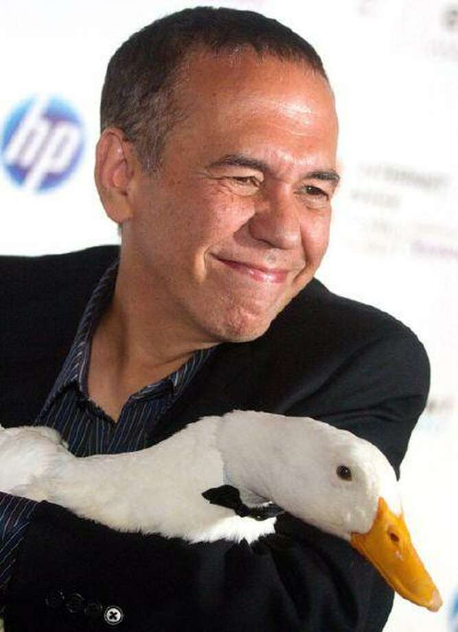 "June 14, 2010 file photo: Comedian Gilbert Gottfried and ""the Aflac duck."" He's been the duck's commercial voice. Photo: AP / AP2010"