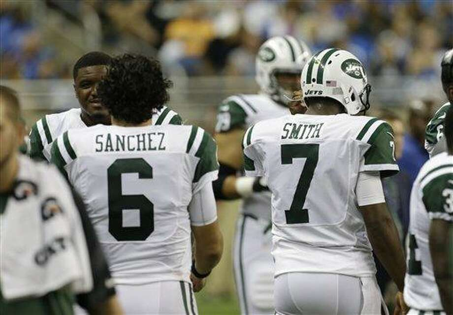 New York Jets quarterbacks Mark Sanchez (6) and Geno Smith are seen in the bench area during the second quarter of an NFL football game against the Detroit Lions at Ford Field in Detroit, Friday, Aug. 9, 2013. (AP Photo/\042011000002\) Photo: AP / \042011000002#3\