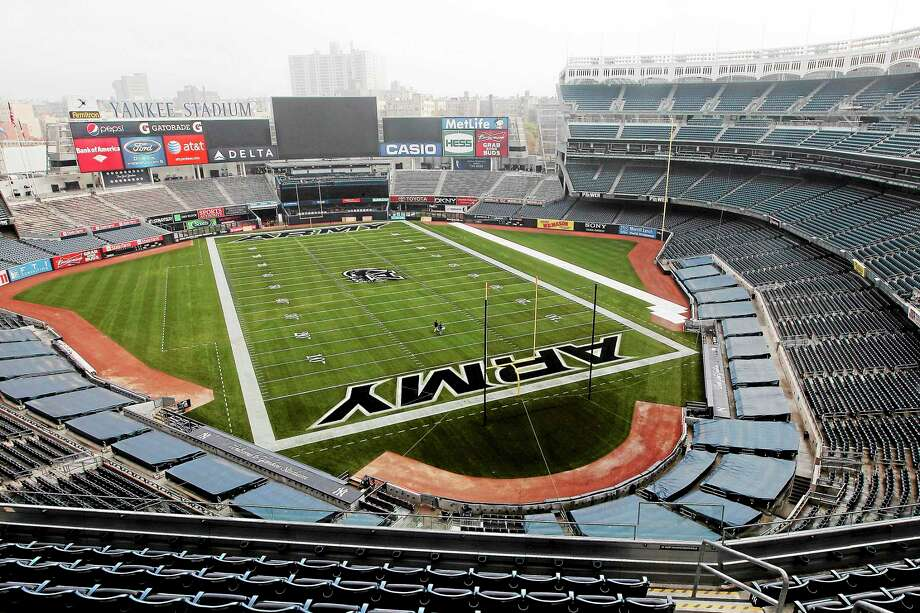 A football field is painted on the field at Yankee Stadium ahead of the Army-Rutgers NCAA college football game, Thursday, Nov. 10, 2011 in New York.  The two teams are scheduled to play on Saturday. (AP Photo/Mary Altaffer) Photo: AP / AP2011