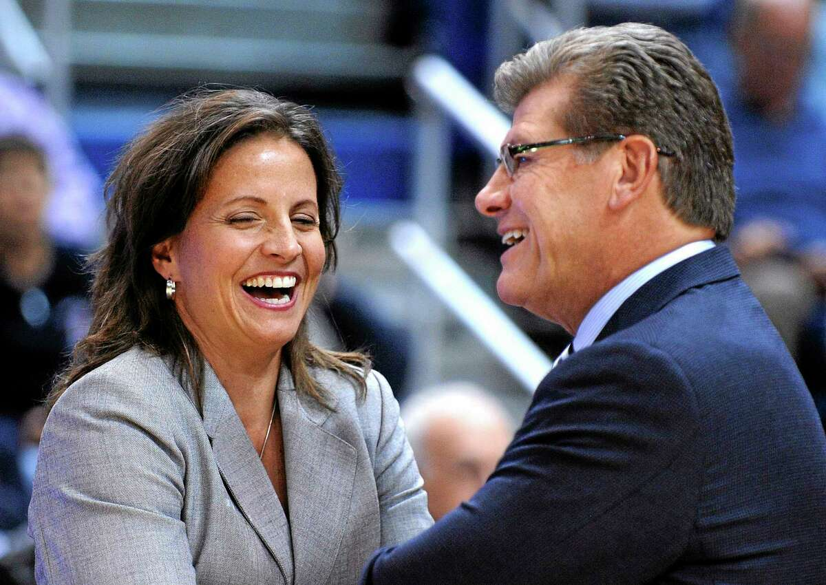 UConn coach Geno Auriemma speaks with Hartford coach Jennifer Rizzotti before Saturday's game in Hartford.