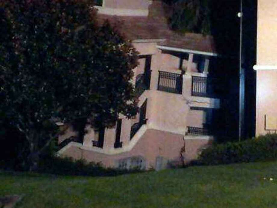 A building  at the Summer Bay Resort in Clermont, Fla, shows damage from collapsing into a sinkhole early Monday Aug. 12, 2013.  No injuries or victims and all emergency responders were safe and uninjured. All guests that were rescued are being moved to a different building on the property. (AP Photo/Alma Rodriquez) Photo: AP / AP2013