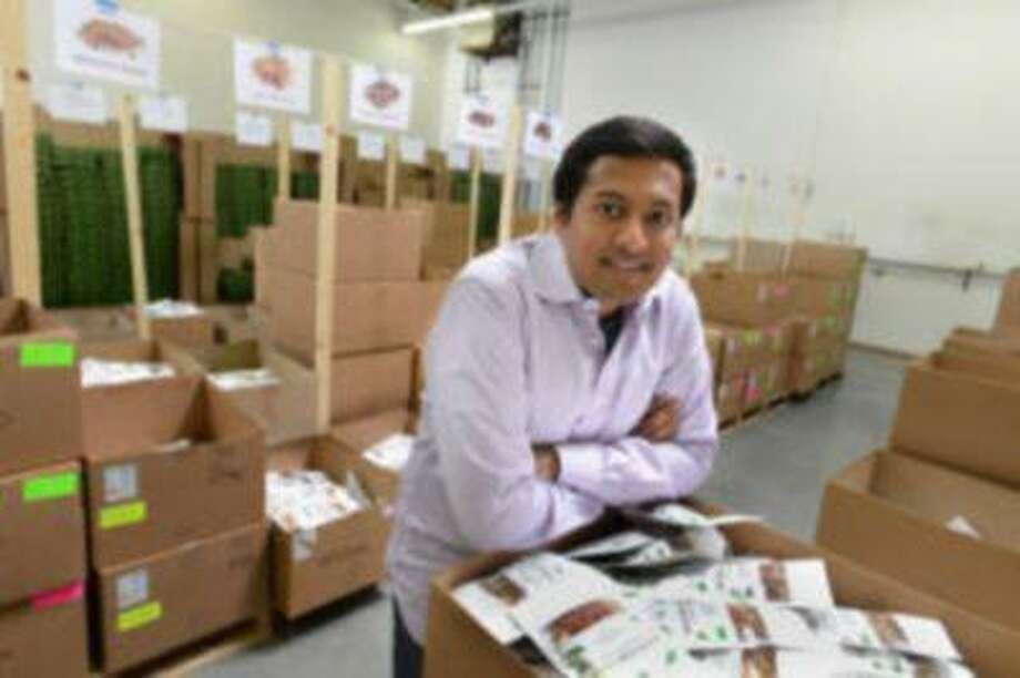 Nature Box Co-Founder Gautam Gupta is photographed in the company's warehouse in San Carlos, Calif. on Friday, March 29, 2013. Nature Box delivers custom snack boxes directly to the homes of customers, allowing people to order snacks online and avoid trips to the store. Photo: Bay Area News Group / Bay Area News Group