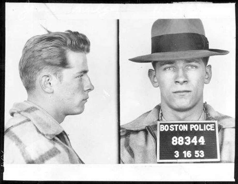 "FILE - This 1953 Boston police booking file photo combo shows James ""Whitey"" Bulger after an arrest. A jury on Monday, Aug. 12, 2013 found Bulger guilty on several counts of murder, racketeering and conspiracy in federal court in Boston.(AP Photo/Boston Police, File) Photo: AP / Boston Police"