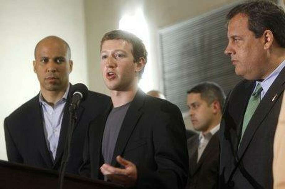 Facebook Chief Executive Officer Mark Zuckerberg, center, is joined by Cory A. Booker, left, the mayor of Newark, N.J., and N.J. Governor Chris Christie, at a 2010 news conference detailing a $100 million deal with New Jersey schools that Zuckerberg and Booker announced. Photo: ASSOCIATED PRESS / AP2010