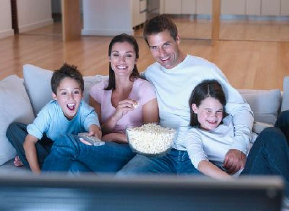 Don't let technology ruin family night - power down your iKindlePadPodTouchPhone thingies and spend time together. Photo: Getty Images/OJO Images RF / OJO Images RF