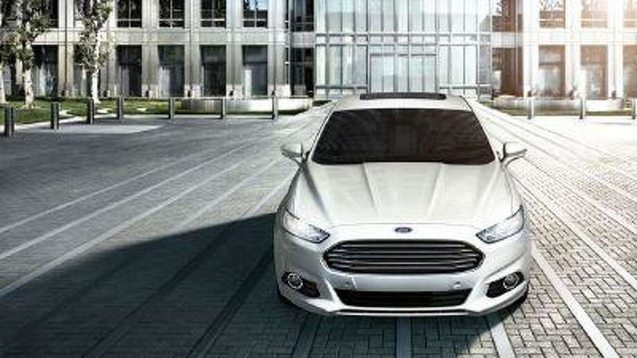 A 2013 Ford Fusion Hybrid. The Fusion, redesigned by Ford late last year, has vaulted into the top five models by U.S. sales early in 2013.