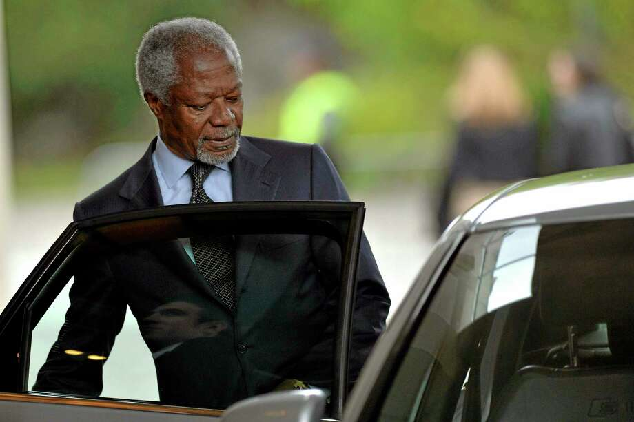 Kofi Annan, Former Secretary General of the United Nations, leaves the hotel, at the second day of closed-door nuclear talks at the United Nations offices in Geneva Switzerland, Friday, Nov.  8, 2013.  U.S. Secretary of State John Kerry warned Friday of significant differences between Iran and six world powers trying to fashion a nuclear agreement, as he and three European foreign ministers added their weight to try to narrow the gap. Officials with delegations at the negotiating table had expressed optimism about progress achieved in Thursday's full day of talks. But comments from Kerry and his counterparts from Britain, France and Germany after they arrived in Geneva clearly indicated that some obstacles remain in the way of any agreement offering sanctions reductions for nuclear concessions.  (AP Photo/Martial Trezzini,Pool) Photo: AP / POOL KEYSTONE